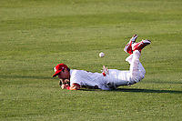 Adam Melker (26) of the Springfield Cardinals misses a diving catch during a game against the Arkansas Travelers at Hammons Field on June 13, 2012 in Springfield, Missouri. (David Welker/Four Seam Images)