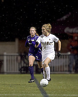 "Boston College forward Kristen Mewis (19) brings the ball out. In overtime, Boston College defeated University of Washington, 1-0, in NCAA tournament ""Elite 8"" match at Newton Soccer Field, Newton, MA, on November 27, 2010."