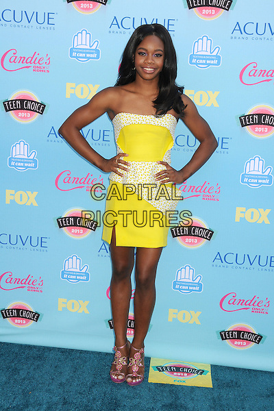 Gabby Douglas, Gabrielle Douglas<br /> 2013 Teen Choice Awards - Arrivals held at Gibson Amphitheatre, Universal City, California, USA.<br /> August 11th, 2013<br /> full length white yellow strapless dress hands on hips<br /> CAP/ADM/BP<br /> &copy;Byron Purvis/AdMedia/Capital Pictures