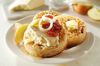 Wensleydale cheese on buttered crumpets stock photos
