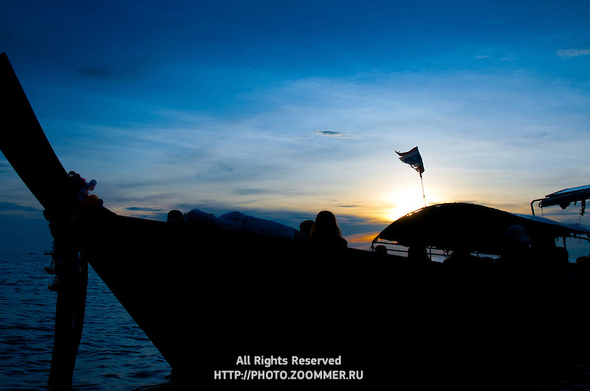 Silhouette of typical Thai longtail boat on the sunset near Phi-Phi island, Thailand