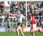 Cathal Malone of Ennistymon in action against Conor Cleary of  St. Joseph's Miltown during the county senior football final at Cusack Park. Photograph by John Kelly.