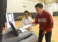 NWA Democrat-Gazette/FLIP PUTTHOFF <br /> Louisa Terrick (cq) (left), poll worker, helps Leigh Freeze cast her ballot Tuesday March 12 2019 during the sales tax election to fund a new courthouse and upgrade the existing courthouse. Freeze voted at Bentonville Church of Christ.