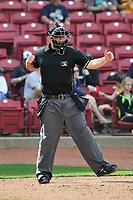 Home plate umpire Nick Susie calls strike three during a game between the Beloit Snappers and the Cedar Rapids Kernels at Veterans Memorial Stadium on April 9, 2017 in Cedar Rapids, Iowa.  The Kernels won 6-1.  (Dennis Hubbard/Four Seam Images)