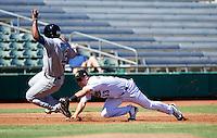 Mesa Solar Sox third baseman Bobby Borchering #53, of the Houston Astros organization, attempts to tag Rymer Liriano #12 sliding into third during an Arizona Fall League game against the Peoria Javelinas at HoHoKam Park on October 15, 2012 in Mesa, Arizona.  Peoria defeated Mesa 9-2.  (Mike Janes/Four Seam Images)