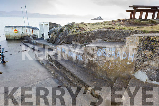 The wall near the bathing slip in Fenit covered in political graffiti on Monday.