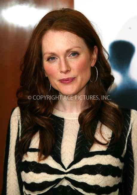 WWW.ACEPIXS.COM . . . . .  ... . . . . US SALES ONLY . . . . ...GERMANY, OCTOBER 22, 2004: Julianne Moore at a photocall for 'The Forgotten', Mandarin Oriental, Germany. ..Please byline: H. Boesl-FAMOUS-ACE PICTURES.... . . . .  ....Ace Pictures, Inc:  ..Alecsey Boldeskul (646) 267-6913 ..Philip Vaughan (646) 769-0430..e-mail: info@acepixs.com..web: http://www.acepixs.com