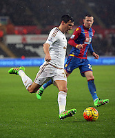 Jack Cork of Swansea croses the ball during the Barclays Premier League match between Swansea City and Crystal Palace at the Liberty Stadium, Swansea on February 06 2016