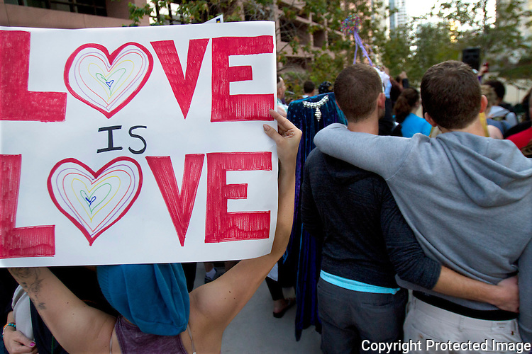 A sign is displayed during a rally in downtown San Diego opposing the state ban on gay marriage in March, 2013. photo  for U-T San Diego