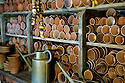 Terracotta flowerpots stacked in potting shed, Heligan, Cornwall.