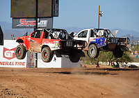 Apr 16, 2011; Surprise, AZ USA; LOORRS driver Wyatt Kirchner (26) jumps alongside Patrick Clark (25) during round 3 at Speedworld Off Road Park. Mandatory Credit: Mark J. Rebilas-.
