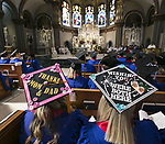 Students wearing decorated mortarboards honoring their parents and grand parents participate in the Baccalaureate Mass at the Saint Vincent de Paul Parish Church on DePaul University's Lincoln Park Campus Friday, June 9, 2017. The event was part of the 119th commencement ceremonies for the Chicago university. (DePaul University/Jamie Moncrief)