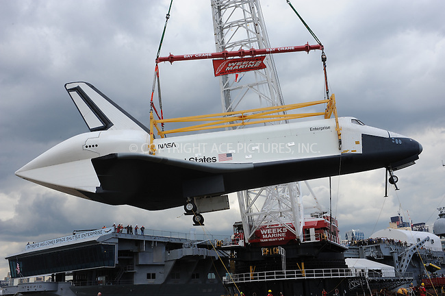 WWW.ACEPIXS.COM . . . . . .June 6, 2012...New York City....The space shuttle Enterprise is lifted by a crane on to the USS Intrepid on June 6, 2012 in New York City ....Please byline: KRISTIN CALLAHAN - ACEPIXS.COM.. . . . . . ..Ace Pictures, Inc: ..tel: (212) 243 8787 or (646) 769 0430..e-mail: info@acepixs.com..web: http://www.acepixs.com .