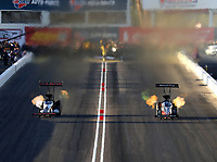 Feb 23, 2018; Chandler, AZ, USA; NHRA top fuel driver Billy Torrence (left) races alongside Clay Millican during qualifying for the Arizona Nationals at Wild Horse Pass Motorsports Park. Mandatory Credit: Mark J. Rebilas-USA TODAY Sports