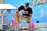 5 November 2011:  FIU Assistant Coach Ignacio Gayo speaks with two swimmers prior to the meet.  The FIU Golden Panthers won the meet with the Florida Atlantic University Owls and Florida Southern Moccasins at the Biscayne Bay Campus Aquatics Center in Miami, Florida.