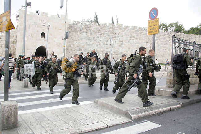 "Israeli border policemen patrol the streets outside Jerusalem's Old City on May 13, 2011 amid tight security in the city, fearing violence as Palestinians began marking the ""Nakba"" or ""catastrophe"" which befell them following Israel's establishment in 1948.  Photo by Mahfouz Abu Turk"