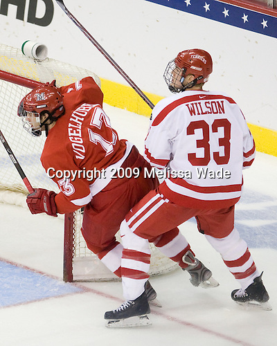 Trent Vogelhuber (Miami - 13), Colin Wilson (BU - 33) - The Boston University Terriers defeated the Miami University RedHawks 4-3 in overtime to win the 2009 NCAA D1 National Championship at the Frozen Four on Saturday, April 11, 2009, at the Verizon Center in Washington, DC.