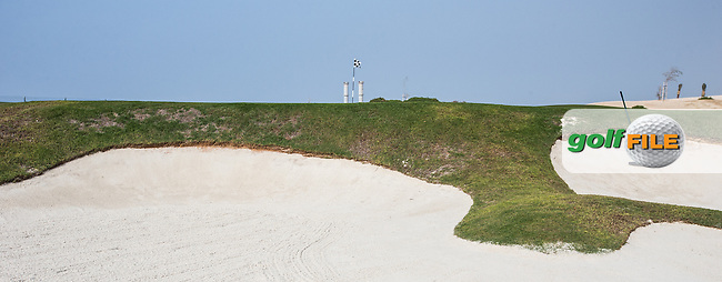 View of the left-side bunker on the 7th at Al Zorah Golf Club, Dubai, United Arab Emirates.  26/01/2016. Picture: Golffile | David Lloyd<br /> <br /> All photos usage must carry mandatory copyright credit (&copy; Golffile | David Lloyd)