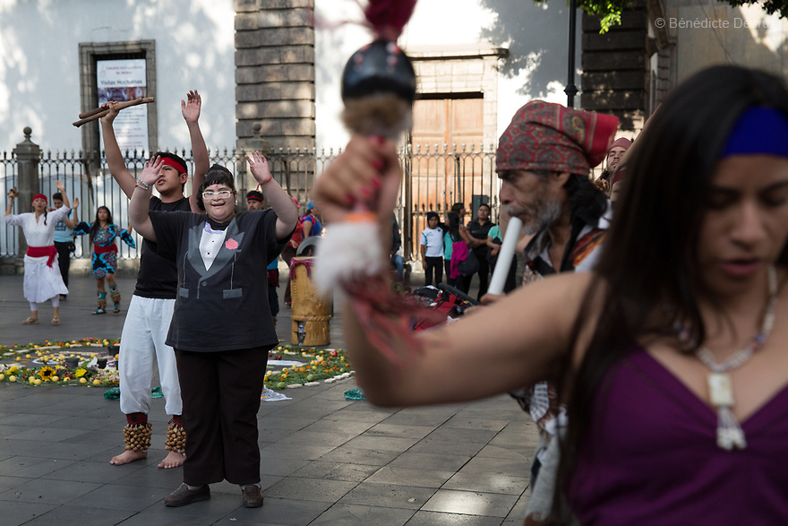 Citlalli dances with Danzantes in the Zocalo main square in Mexico City, Mexico on July 15, 2017. Delia Citlalli Pineda Corzo, a 21-year-old Mexican girl, lives with her 42-year-old mother Diana Cristina Corzo Zárate in a two-room apartment in Mexico City. She was diagnosed with Prader-Willi syndrome at age four. At age 15, doctors detected that she had diabetes. Citlalli weighs 106 kilos (233.6 pounds) and stands 150 centimeters (4 feet 11 inches). She has a BMI of 50.5, making her morbidly obese. She also suffers from sleep apnea. Citlalli lacks the faculty of speech and cannot read, but her mother says they have developed their own form of communication. Prader-Willi Syndrome (PWS) is a rare genetic disorder caused by an abnormality in chromosome 15. In newborns symptoms include weak muscle tone (hypotonia), poor appetite and slow development. In childhood the person experiences a sensation of constant hunger no matter how much he/she eats which often leads to obesity and Type 2 diabetes. There may also be mild to moderate intellectual impairment and behavioral problems. Physical characteristics include a narrow forehead, small hands and feet, short in stature, and light skin color. Prader-Willi syndrome has no known cure. However, with early diagnosis and treatment such as growth hormone therapy, the condition may improve. Strict food supervision is typically required. PWS affects an estimated 1 in 10,000 to 30,000 people worldwide. (Photo by Bénédicte Desrus)
