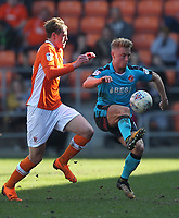 Blackpool's Sean Longstaff in action with Fleetwood Town's Kyle Dempsey<br /> <br /> Photographer Mick Walker/CameraSport<br /> <br /> The EFL Sky Bet League One - Blackpool v Fleetwood Town - Saturday 14th April 2018 - Bloomfield Road - Blackpool<br /> <br /> World Copyright &copy; 2018 CameraSport. All rights reserved. 43 Linden Ave. Countesthorpe. Leicester. England. LE8 5PG - Tel: +44 (0) 116 277 4147 - admin@camerasport.com - www.camerasport.com