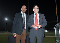 "Track athlete Steve Haas '63 receives his recognition. One of the most versatile all-around runners in Oxy track and field history, Steve Haas '63 set school records in the 100, 220, 440, and 880 during the 1963 season. He also was a member of Oxy's school record 2-mile relay team. In the words of one onlooker, ""Haas was a beast in every event.""<br /> The Occidental community celebrates its student-athletes with the induction of the sixth class into the Occidental College Athletics Hall of Fame during Homecoming and Family Weekend on Friday, Oct. 13, 2017 in Jack Kemp Stadium. The 2017 inductees are Stephen Haas '63 (track and field), the 1982 women's tennis team (NCAA national champions), Blair Slattery '94 (basketball and tennis), and the late Andy Collins '07 (football, track and field).<br /> (Photo by Marc Campos, Occidental College Photographer)"