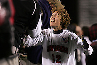 New Mexico's Chris Wright celebrates with fans after the game. The University of New Mexico Lobos defeated the Clemson University Tigers 2-1 in a Men's College Cup Semifinal at SAS Stadium in Cary, NC, Friday, December 9, 2005.