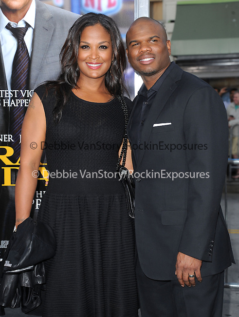 Curtis Conway and Laila Ali attends The L.A. Premiere of Summit Entertainment's DRAFT DAY held at The Regency Village Theatre in Westwood, California on April 07,2014                                                                               © 2014 Hollywood Press Agency