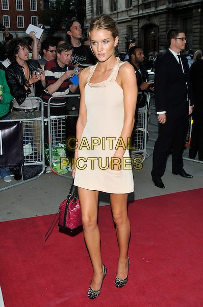 ROSIE HUNTINGTON WHITELEY.The GQ Men Of The Year Awards 2009 held at the Royal Opera House, Covent Garden, London, England..8th September 2009.full length red pink Lous vuitton bag peach pale beige dress cream hand in pocket .CAP/PL.©Phil Loftus/Capital Pictures.