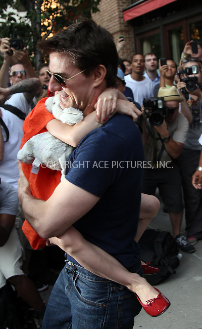 WWW.ACEPIXS.COM . . . . .  ....July 17 2012, New York City....Actor Tom Cruise carries his daughter Suri Cruise out of a downtown hotel following an afternoon together on July 17 2012 in New York City....Please byline: Zelig Shaul - ACE PICTURES.... *** ***..Ace Pictures, Inc:  ..Philip Vaughan (212) 243-8787 or (646) 769 0430..e-mail: info@acepixs.com..web: http://www.acepixs.com