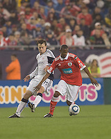 SL Benfica midfielder Airton (2) controls the ball as New England Revolution forward Zack Schilawski (15) defends. SL Benfica  defeated New England Revolution, 4-0, at Gillette Stadium on May 19, 2010.