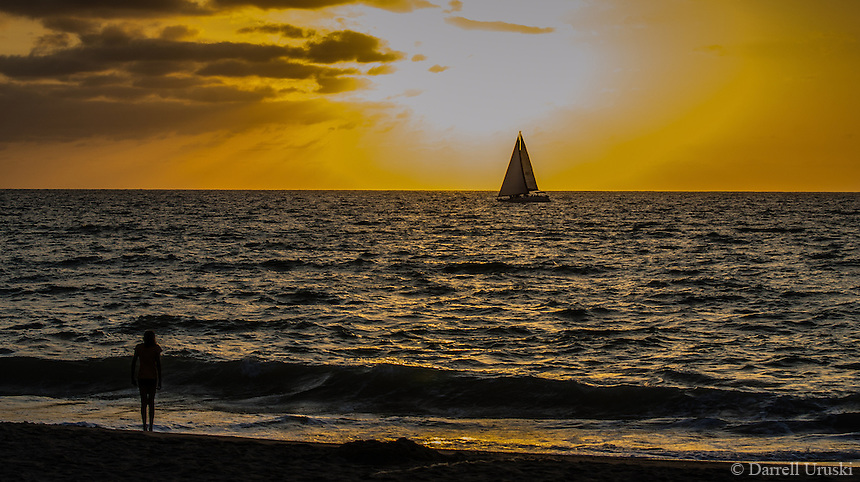 Fine Art Landscape Photograph, Sunset in Banderas Bay, Puerto Vallarta, Mexico. Sailboat passes by the setting sun.