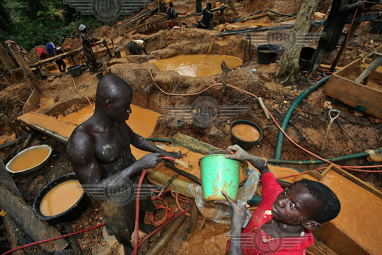 Young men work on a gold mining site in Obuasi. Many unemployed young people have taken to working as illegal artisanal gold miners known as galamseys in Ghana.