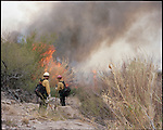 Mexican firefighters cross the Rio Grande River at the Boquillas border crossing for a controlled burn at Big Bend National Park in Texas.<br /> <br /> Photographs by Ben Sklar