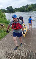 NWA Democrat-Gazette/FLIP PUTTHOFF <br /> The volunteer spirit is a big part of the trip. Paddlers help each other get their boats in and out of the water each day. Everyone who organizes and leads the trip is a volunteer. Here paddlers help each other get boats out of the water July 31 2018 on the Des Moines River.
