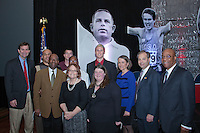 Members of the Timmons and University of Kansas Family stand in front of the Bob Timmons image at the National Track and Field Hall of Fame Induction Ceremony during the 2011 USA Track and Field Annual Meeting in St. Louis, Missouri, Saturday December 3. Coach Bob Timmons was inducted into the National Track and Field Hall of Fame after an extraordinaty career at Wichita East High School and The University of Kansas.