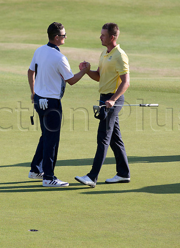 14.08.2016. Rio de Janeiro, Brazil.  Henrik Stenson, right, congratulates Great Britain's Justin Rose on his gold medal, Men's Individual Stroke Play Round 4 of the Golf events during the Rio 2016 Olympic Games at the Olympic Golf Course in Rio de Janeiro, Brazil, 14 August 2016.