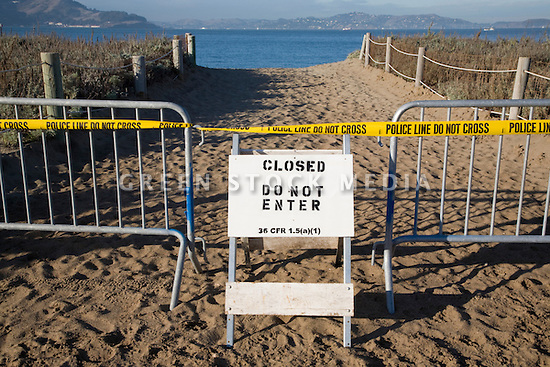 Gates, police line tape, and a do not enter sign block off a path to Crissy Field beach on San Francisco Bay (11/12/07). On November 7, 2007 the Cosco Busan container ship spilled an estimated 58,000 gallons of bunker fuel into San Francisco Bay after striking a tower of the San Francisco-Oakland Bay Bridge.