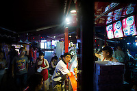 People line up at franchise food vendors fill up Deyi World plaza near the Jiafengbei central business district in Yuzhong district, Chongqing, China.