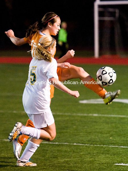 WOLCOTT, CT-27 October 2014-102714EC04--   Watertown's Rebecca Lopes kicks the ball in front of Holy Cross' Kylie Rice Monday night in Wolcott. The Crusaders lost to the Indians, 2-0. Erin Covey Republican-American