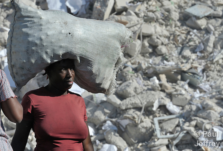 A Haitian woman walks in the devastated center of Port-au-Prince, Haiti, which was ravaged by a January 12 earthquake.