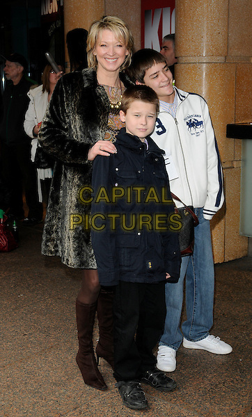 "GILLIAN TAYLFORTH.At the ""How To Train Your Dragon"" VIP gala screening, Vue West End cinema, Leicester Square, London, England, UK, 28th March 2010..full length family sons children kids grey gray fur coat boots brown knee high .CAP/CAN.©Can Nguyen/Capital Pictures"