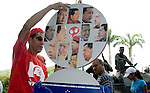 Eduardo Yepez, supporter of  Venezuelan president Hugo Chavez displays photos with his face after a military parade in Caracas, Venezuela, on Wednesday, Jul. 05, 2006. The military parade was to celebrate the 195th anniversary of the Venezuelan Independence from Spain. (ALTERPHOTOS/Alvaro Hernandez)