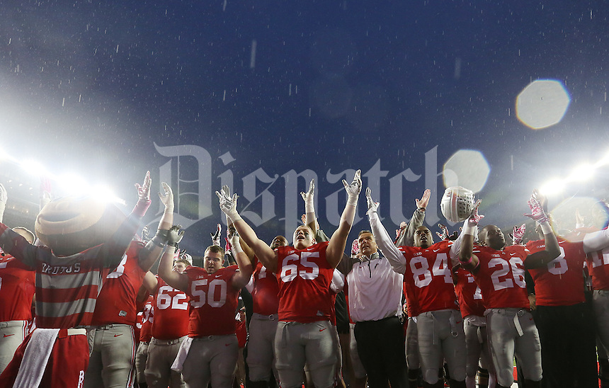 Ohio State players sing Carmen Ohio after an NCAA college football game between The Ohio State Buckeyes and the Rutgers Scarlet Knights at Ohio Stadium on Saturday, October 18, 2014.  (Columbus Dispatch photo by Fred Squillante)