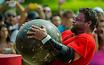 HAINAN ISLAND, CHINA - AUGUST 24:  Mike Burke of USA competes at the Atlas Stones event during the World's Strongest Man competition at Yalong Bay Cultural Square on August 24, 2013 in Hainan Island, China.  Photo by Victor Fraile