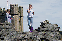 Aberystwyth Wales Uk, Sunday 08 May 2016<br /> Pictured: A young woman photographs in the ruins of Aberystwyth castle<br /> UK Weather : As temperatures reach the upper 20's centigrade in parts of Britain, people enjoy the warm May sunshine in Aberystwyth on the Cardigan Bay coast in West Wales.