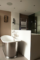 The bathroom is furnished with a free-standing bath