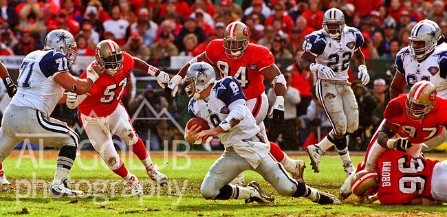 San Francisco 49ers vs. Dallas Cowboys at Candlestick Park Sunday, January 15, 1995.  49ers beat Cowboys 38-28.  Dallas Cowboys quarterback Troy Aikman (8) trapped by San Francisco 49ers linebacker Rickey Jackson (57) and defensive tackle Dana Stubblefield (94).