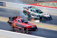 Sept. 19, 2010; Concord, NC, USA; NHRA funny car driver Bob Tasca III (near) races alongside Ashley Force Hood during the O'Reilly Auto Parts NHRA Nationals at zMax Dragway. Mandatory Credit: Mark J. Rebilas-