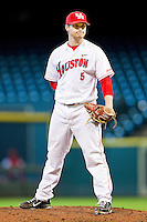Houston Cougars relief pitcher Codey Morehouse #5 looks to his catcher for the sign against the Arkansas Razorbacks at Minute Maid Park on March 3, 2012 in Houston, Texas.  The Cougars defeated the Razorbacks 4-1.  (Brian Westerholt/Four Seam Images)