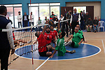 Palestinian players from al-Sadaqa club (green) and al-Helal club (Red) compete in the final of the sitting volleyball event in Gaza city on March 06, 2019. Photo by Mahmoud Ajjour